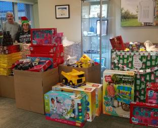 Toys for Tots donations overflow the boxes at Onset!