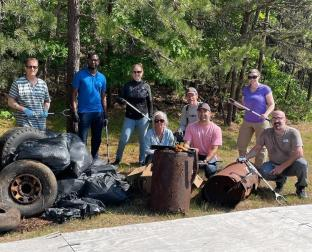 Onset teams take part in a clean up activity after World Environment Day